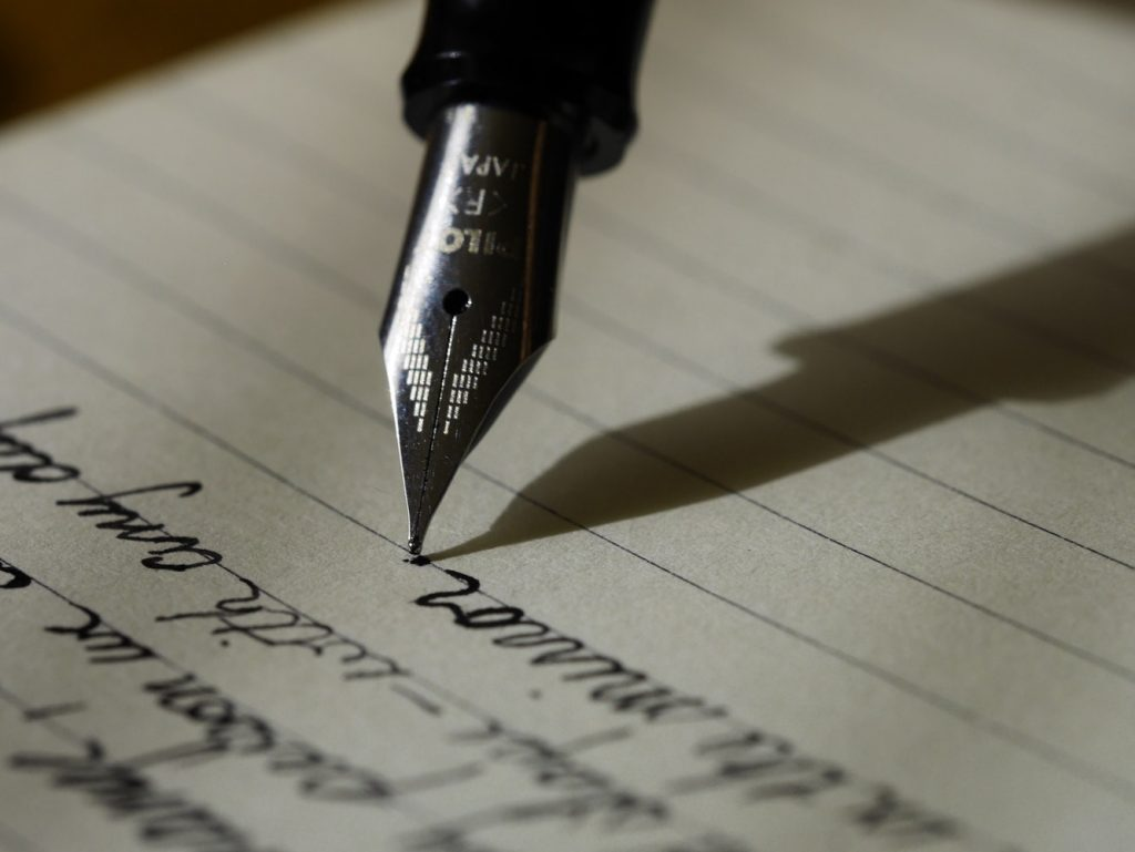 A person writing and practicing for a speech