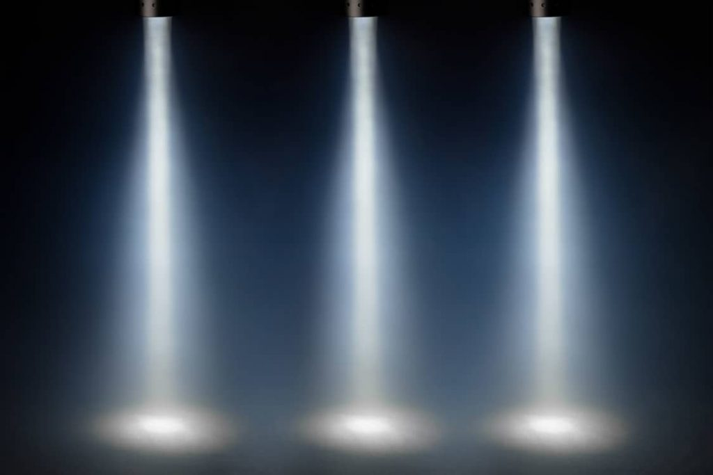 3 spotlights to emphasise the rule of three in speech writing