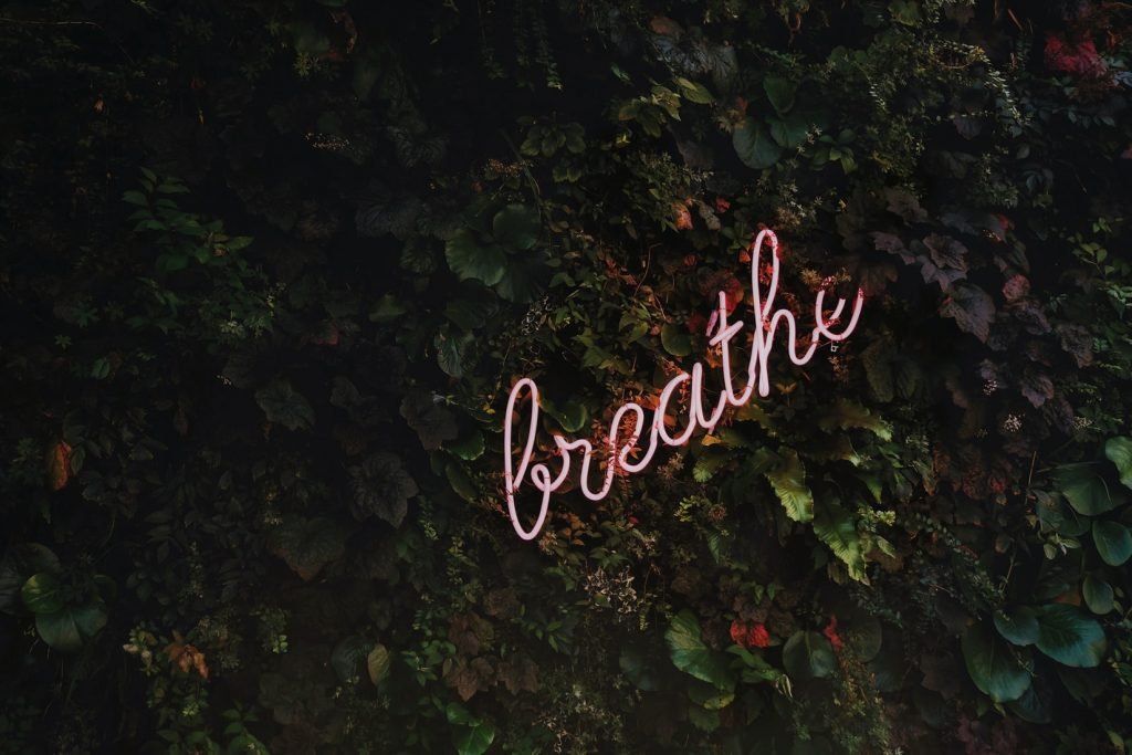 breathe and relax to loosen up your body before a speech or presentation