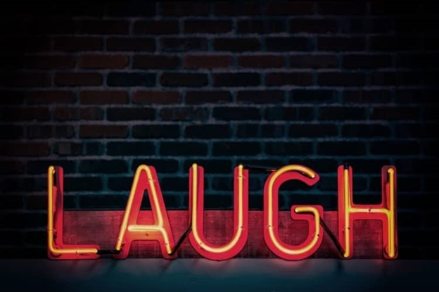 The emotion of humour shown by the action of a laugh.