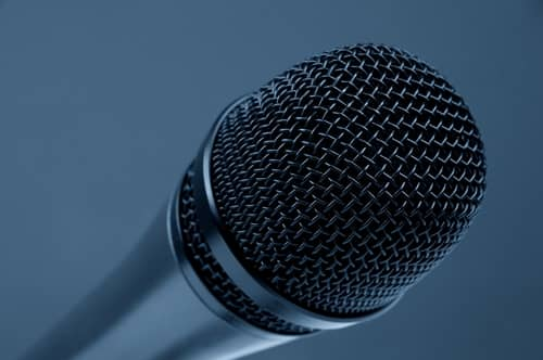 A mic, very often used by public speakers during events. Essential to address a large audience.