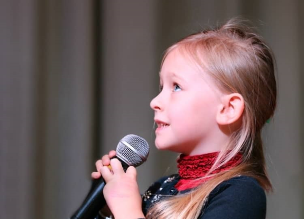In this picture, we see how children can try to overcome their fear of public speaking.