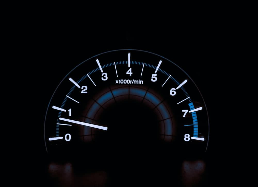 A vehicle's speedometer referring to fast talkers.
