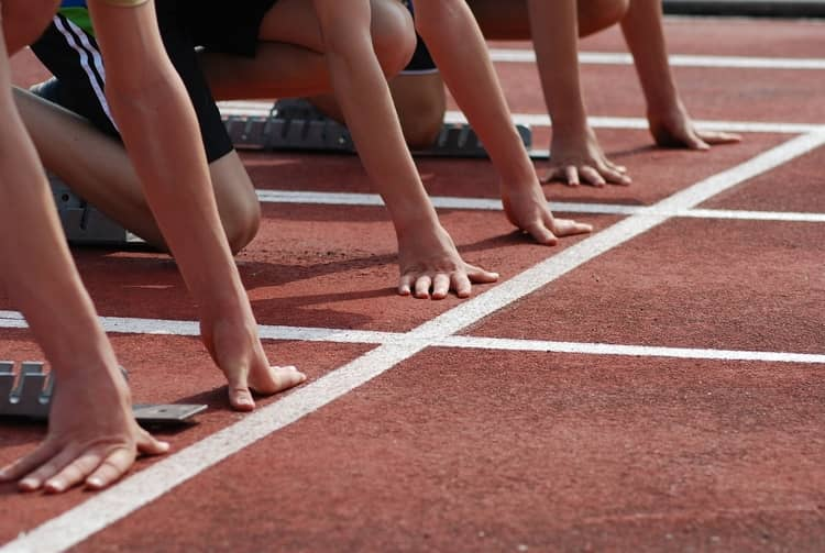 participants lined on their mark on a racetrack before starting the race.