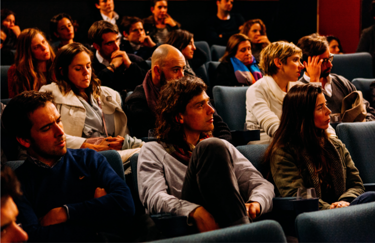 An audience listening to an engaging presentation.