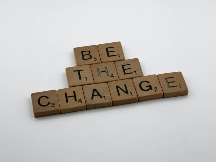 """woodblocks with the words """"BE THE CHANGE"""" written on them."""