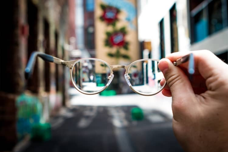 a pair of glasses suggesting viewing the world through another person's perspective.
