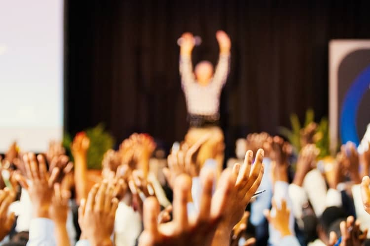 a public speaker demonstrating an activity to his audience